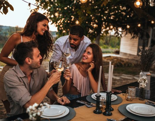 Friends enjoying a dinner party out in the yard